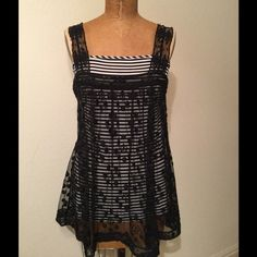 BCBGMaxAzria Black/White Top If interest is what your after in a wardrobe piece, this top says it all and more! Top has black/white striped knit tank underneath and overlaid with black embroidered lace mesh top. Pieces are attached, but could be easily separate. Lace mesh overlay top has adjustable straps. Fabric is Rayon and Polyester. Dry Clean. BCBGMaxAzria Tops