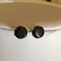 HP14k gold black spinel earrings Beautiful 8mm natural black spinel set in 14k gold. The posts are a little bent. I was in a hurry to get out of the house and was a little rough on them. They are stunning.  They have butterfly backs.  As with all my gold PRICE IS FIRM Jewelry Earrings