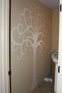 Paint tree on wall. Might do this in my hallway and put up pictures frames on the tree. Like a family tree.