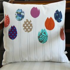 A gorgeous hand made cushion depicting multi coloured tulips in a vintage patchwork style on a cream background. The clever combination of retro and vintage fabrics makes this cushion unique and individual. Designed and made with love in rural Devon. Perfect for a birthday, wedding or housewarming gift. Featured on ITV's This Morning.