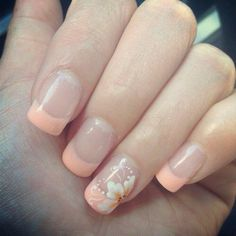 Soft coral French tips with a flower design