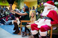 """First Lady Michelle Obama, with Bo on her lap, reads """"'Twas the Night Before Christmas"""" at the Children's National Medical Center in D.C., Dec. 14, 2012. Watch: http://wh.gov/Q9KQ"""