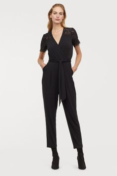 Jumpsuit with Lace Yoke - Black - Ladies. Jumpsuit in soft jersey with a yoke and short sleeves in lace. V-neck, attached wrapover at front, seam at waist with a wide tie belt, and side pockets. Clothing Blogs, Size Clothing, Affordable Work Clothes, Holiday Party Outfit, Party Outfits, Cold Weather Outfits, Best Jeans, Jumpsuits For Women, Latest Fashion Trends