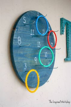 A twist on the classic ring toss, this DIY ring toss game is wall mounted and offers many ways to play! Diy Yard Games, Diy Games, Backyard Games, Outdoor Games, Party Games, Peg Board Hooks, Wall Game, Ring Toss, Diy Porch