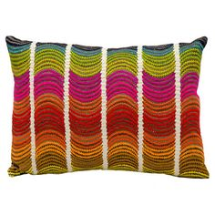 Bring a pop of style to your sofa or favorite reading nook with this chic pillow, featuring a multicolor wave motif for vibrant style.