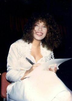 Selena signing autographs
