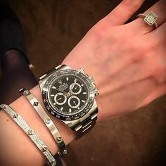 Diamond ring matched with a black dial #Rolex #Daytona. Great combination!