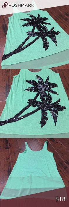 Palm tree tank Fun sparkly palm tree tank can be dressed up or down.  The palms are filled with black sequins and the back has a mesh part to it.  Great condition as it was worn once. Express Tops