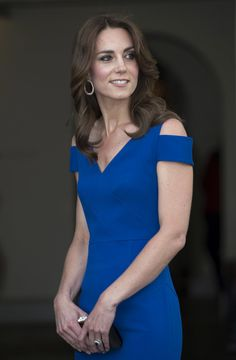 Kate Middleton Lookbook: Kate Middleton wearing Roland Mouret Evening Dress (1 of 28). Kate Middleton cut a sophisticated figure in a cobalt cold-shoulder column dress by Roland Mouret at the 40th anniversary of SportsAid.