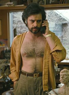 Jemaine Clement in Gentlemen Broncos.  What's hotter than a dude with full, fluffy chest hair?  A dude wearing a BLUETOOTH!!!  (swoon!)