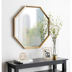 Add a modern accent to a hallway, entryway and more with the Calter Wall Mirror by Kate and Laurel. Featuring a chic geometric shape with a simple frame, this elegant mirror brings a polished look to your wall. Gold Frame Wall, Frames On Wall, Framed Wall, Gold Wall Mirror, Wall Art, Contemporary Wall Mirrors, Modern Contemporary, Octagon Mirror, Interior Decorating Styles