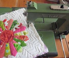 quilting my craftsy BOM with the grasshooper !