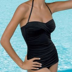 Retro Swimsuit Jantzen Vamp Maillot One Piece Bathing Suit by Jantzen Swimwear has an elegant silhouette with front shirring and a detachable strap. A flattering lower leg for a Vintage, Retro look. Available in black and red.