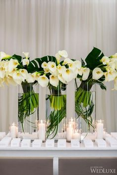 WedLuxe – An Elegant and Timeless Wedding | Photography by: Ikonica Follow @WedLuxe for more wedding inspiration! Recreate this amazing centerpiece with faux calla lilies, tropical leaves, and glass cylinders from afloral.com. http://bit.ly/23O5UHW