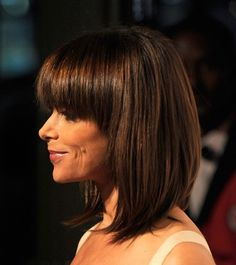 long bob with bangs - I like how they extend back toward the ears to keep the face open.