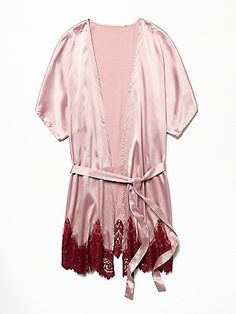 "She's a Knockout Robe | Get wrapped up in this romantic little robe, silky with a wide scalloped lace trim. Drapey short sleeve silhouette that ties at the waist.  *By SKIVVIES by For Love & Lemons   *Derived from those sun-soaked ""Lemonade Stand Days,"" designers, owners, and BFF's Gillian Mahin and Laura Hall are the masterminds behind For Love & Lemons. Based in Los Angeles, the collection is anything but conventional. For Love & Lemons is a brand for that girl who doesn't follow trends…"
