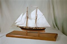 """US Revenue Cutter JOE LANE, scratchbuilt wood model...    This model represent this topsail schooner in her 1855 configuration. Made entirely of wood, with minute detail applied to her sails and rigging, she sets in a handsome custom finished base and is 21"""" LOA. Her scale is 1/8"""" = 1'. For more information about these detailed models email: Caseships@yahoo.com or visit http://www.artfixdaily.com/blogs/post/2661-miniature-collectibles---the-stewart-collection-of-classic-ships"""