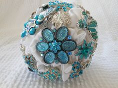 Here is one of the bridesmaid bouquets, which I also made.  Their bouquets include teal brooches to match the dresses.