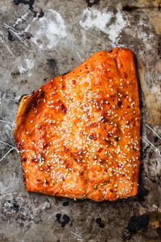 Healthy honey marinated sriracha salmon served over a delicious spiralized sesame cucumber noodle salad.