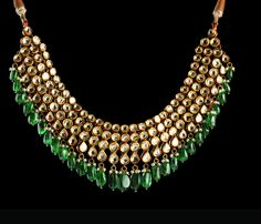 Dazzle around with this delicately crafted kundan necklace adorned by emeralds, ideal for any occasion during the upcoming wedding and festive season.