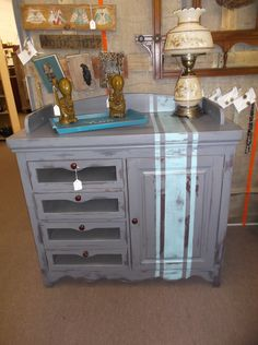 SOLD - Mini serving bar - could also be a changing table - 4 drawers & 1 cabinet - painted gray with light blue/turquoise stripes - antiqued & distressed.  ***** In Booth D15 at Main Street Antique Mall 7260 E Main St (east of Power RD on MAIN STREET) Mesa Az 85207 **** Open 7 days a week 10:00AM-5:30PM **** Call for more information 480 924 1122 **** We Accept cash, debit, VISA, MasterCard or Discover