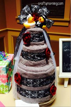 Learn how to make a bridal shower towel cake for a creative gift idea! Here you can see step by step how to make it with towels! Great for the bride to be!