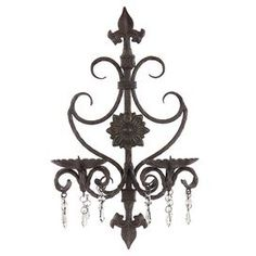 "Wrought iron candle sconce with crystal-drop accents.     Product: Wall sconceConstruction Material: Wrought iron  Color: Black  Features: Crystal accent beadsAccommodates: (2) Candles - not includedDimensions: 19"" H x 11.5"" W x 6.5"" D"