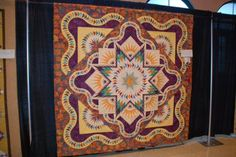 "Glacier Star designed by Quiltworx.com, made by Leslie Kiger.  2nd Place in the ""Team Large Pieced"" category at Pine Belt Quilters Fiber Art and Quilt Show, Hattiesburg, MS."