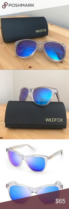 Wildfox Catfarer Deluxe Sunglasses Super cute Wildfox Catfarer Deluxe sunglasses - clear frame with mirror blue / purple lenses. These beauties will keep you cool by the pool. Worn once, no scratches, comes with case.  My sister got them for me and I LOVE them but they just don't fit my face well. ❌No trades Wildfox Accessories Sunglasses