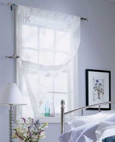 White, sheer window treatment - perfect to let light in while retaining privacy!