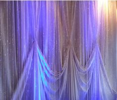 one pin ivory backdrop with layered crystal bead strands, blue ice led lighting