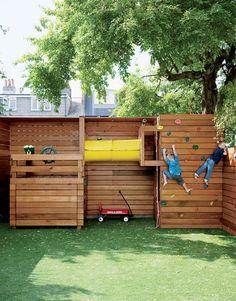 Custom playset and climbing wall in London backyard.