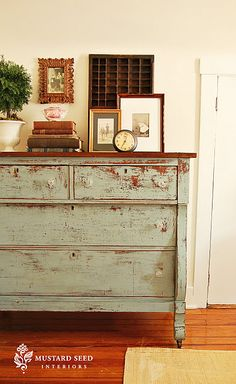 Really want to try this! Distressed dresser painted with old fashioned milk paint in Sea Green. This woman's blog is amazing.