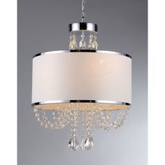 Update your decor with this modern shade chandelier with crystals. This elegant fixture has a chrome finish that gives it a modern look. The row of hanging cascading crystals makes it sparkle, and its fabric shade beautifully filters light.