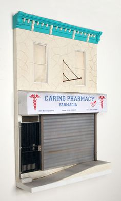 """Caring Pharmacy"" by Drew Leshko 24""h x 16""w x 4""d illustration board, wire, plaster, paper, basswood, acrylic, enamel"