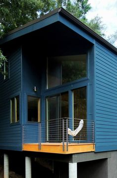 This 950 sq. ft. small housewas designed for a family by Rusafova Markulis Architects. It's called The Blue House and was created specifically for their clients needs. Since the home is insp…