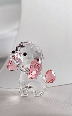 Swarovski Puppy - Rosie the Poodle - Representing peace and love, Puppy - Rosie The Poodle will put a smile on your face. She is crafted in a sparkling mix of clear and pink crystal, creating an eye-catching effect. A great gift for dog owners! Swarovski Crystal Figurines, Swarovski Crystals, Girly Things, Cool Things To Buy, Lila Baby, Accessoires Iphone, Kawaii Accessories, Magical Jewelry, Cute Room Decor