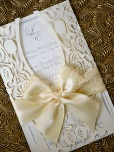 Laser Cut Romantic Invitation by DreamMakersInvites on Etsy blue ribbon and silver laser cut.
