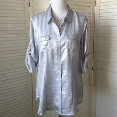 Metallic silver Calvin Klein camp shirt I love this! Long sleeves with roll tabs. Collar, button front, two breast pockets. Classic camp styling in a super sleek crinkle metallic silver fabric that hangs beautifully. NWT; never worn. Calvin Klein Tops Button Down Shirts
