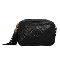 36a699ab6 Bag yourself a beauty this winter with this classic boxy vintage Chanel  camera bag with tassel