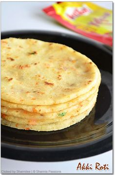 Instant Akki Roti Recipe Rice flour - 1.5 cups Onions - 1 finely chopped Ginger - 1 tbsp finely chopped Chilli powder - 1/2 tsp (optional) Turmeric powder - a small pinch Jeera - 1 tsp Carrot - 1 medium sized, grated Coconut - 2 to 3 tbsp grated Coriander leaves - 1 tbsp finely chopped Hing - a pinch Green chillies - 1 finely chopped Salt - to taste Oil - to toast
