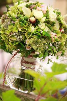 Monochromatic greens. Wildflower from the English country side make this a romantic and whimsical bouquet.