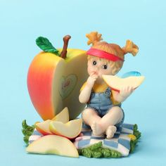 My Little Kitchen Fairies Good Choice Fairy Figurine, an inspirational fairy enjoying one of her favorite snacks.