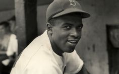 Breaking Baseball's Barrier  On April 15, 1947, Jackie Robinson made his debut as a Brooklyn Dodger, becoming the first black player to break the color barrier in Major League Baseball.