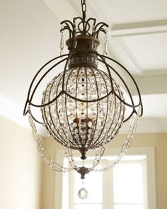 Encased crystal Chandelier. Inspired by 19th-century European regency and neoclassical designs. Looks like a hot air balloon.