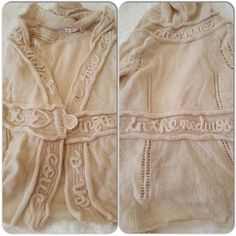Anthropologie rare sweater Simply beautiful had to reposh, never worn, its size Medium and i just couldn't pull it off. Beautiful writing throughout the cardigan/sweater, double buttons at waist. Hooded. In great condition. Anthropologie Tops