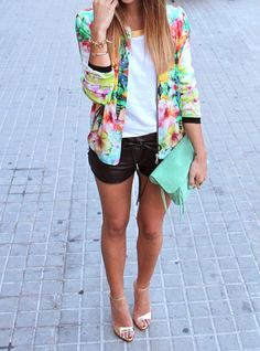 Never would have thought leather shorts could be so cute....who knew! And the blazer with floral patterns really makes this outfit POP!