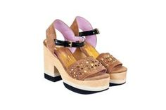 Sandalias con plataforma de madera (Sybil Vane $1298).