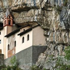 The evocative hermitage of San Colombano carved in the rock
