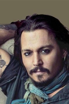 Johnny Depp. Not in pirate attire but still wearing the eyeliner. Don't judge me.